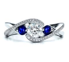 Diamond and sapphire ring with infinity twist