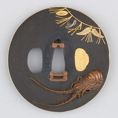 Grayfish tsuba. Shakudo, gold, silver & copper