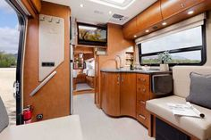 """2016 New Leisure Travel UNITY 24TB Class B in North Carolina NC.Recreational Vehicle, rv, ON ORDER! The Leisure Travel Van U24TB B+ motor home is the Unity's Twin Bed floor plan and it has a very practical interior. This compact luxurious motor home features curved European cabinets throughout, a split bathroom, a private bedroom area with twin beds, light Sierra Maple Cabinets, and many other great features. The Leisure Travel Unity U24TB is one big """"little"""" motor home. The ETA for this new… Alcoa Aluminum, Leisure Travel Vans, Gas Generator, Maple Cabinets, Benz Sprinter, Class B, Entry Doors, Motorhome, Solar Panels"""
