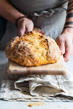 Crusty Irish Soda bread with grated vintage cheddar and rosemary mixed all through the dough. You definitely need this for your St Patrick's Day dinner! #stpatricksday #irishsodabread #sodabread #Stpattys