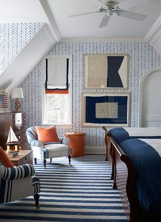 [CasaGiardino] ♛ A graphic Serena & Lily wallpaper enlivens the boys' room; chairs upholstered in a denim stripe by Ralph Lauren Home flank an 1870 English chest, the framed naval flags are vintage, and the rug is by Montagne Handwoven. Decor, Blue Decor, House Design, House, Interior, Home, House Interior, Bedroom Decor, Interior Design