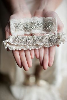 bridal garters crafted with beautiful silks, lovely hand-beaded lace, & dazzling crystals