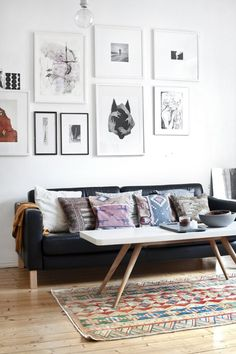 Add a dash of bohemian flair to your living room decor w/ an eclectic wall gallery, stunning accent rug, & unique mix of tribal patterned accent pillows!
