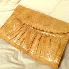 Vintage snakeskin envelope clutch what a versatile clutch/ purse! Vintage but in brand new condition! This has been in my closet for a while now and I have never actually used it. Single button closure, can be carried like a clutch or removable shoulder strap can be used as purse. Super cute tan color goes with everything!!! Bags Clutches & Wristlets