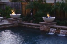 "Simplicity Fire Bowl from Concrete Creations LA, custom fire pits. Available in widths ranging from 24"" to 54"", with 4 different finishes and 3 colors to choose from. Two fire bowls on columns above fountain."