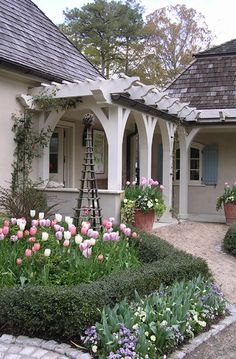 The curved bracket on the posts of this pergola enhances the entry much more than just the main supportive posts by themselves would have done  ... And the end cuts made to the overhead cross pieces add even more stature to the pergolas's appearance...