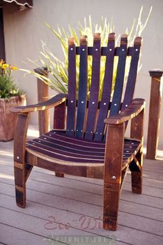 """The Demonte Chair has a solid, sturdy design with wide armrests. Handcrafted from wine barrel staves, this chair can be combined with the Demonte Two Seat Chair for a perfect match.  45""""H X 26.5""""W X 17.75""""D"""