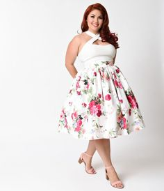 A florists dream of blooming splendor, dames! Freshly cut from Unique Vintage, this graceful plus size 1950s inspired skirt is crafted in a woven satin like blend for a luxurious smooth touch. A gorgeous print of posies and green leaves dance on a bright