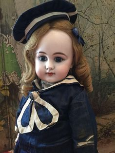 Here we an absolutely adorable and complete original doll, Dep Bebe, the bisque head made by Simon Halbig, with blue paper weight eyes, closed mouth,