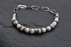 Hey, I found this really awesome Etsy listing at https://www.etsy.com/listing/485057103/raw-silver-and-pearl-bracelet-oxidized