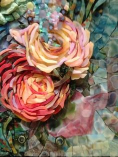 Stained glass 3-dimensional rose mosaic, achieved in layers. Very effective!