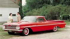 1959 El Camino. This was my first El Camino, at least one just like this one. Red in color, 3 speed, drove like a old Boat. CZ motorcycle in the back. The wings where perfect for standing on to tie down the motorcycles.