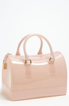 I'm not traditionally a fan of Designer clear plastic totes and rubber bags that appear in Spring - but this Furla bag is so etherial and ladylike, with a playful, contemporary edge. It's also not totally see-through which is a bonus! This is a Fun Tote! Definitely a Must Have! Makes me think of Cotton Candy!
