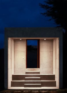 ○ Detached from the main structure, a stepped entryway leads into the property.