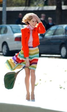 Carrie's rainbow skirt, pink top, red jacket...and giggly attitude.