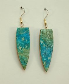 Use polymer clay to create shapes for earrings