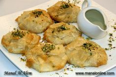 The Kitchen (The home of Delicious Arabic Food) invites you to try Broiled Filo Rounds recipe. Enjoy the Arabic cuisine and learn how to make Broiled Filo Rounds. Middle Eastern Desserts, Arabic Food, Arabic Sweets, Eastern Cuisine, Lebanese Recipes, Hummus Recipe, Recipe Sites, Savoury Dishes, Mediterranean Recipes