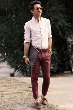 Shop this look on Lookastic:  https://lookastic.com/men/looks/dress-shirt-chinos-boat-shoes-zip-pouch-belt-sunglasses-watch/11929  — Tan Sunglasses  — Beige Dress Shirt  — Brown Leather Belt  — Dark Brown Print Leather Zip Pouch  — Silver Watch  — Burgundy Chinos  — Brown Leather Boat Shoes