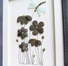 This OOAK pebble / sea glass art could be the perfect gift for a new home housewarming, birthday, anniversary. Genuine sea glasses in aqua sea foam color are used to create a dragonfly, beach pebbles in a grey color are used to create flowers. Unique home décor made from a variety of hand picked materials hand collected by me from the beaches near Varna town. Size: 20 cm x 28 cm / approx 8 x 11 / Framed with a white matting and custom made wooden frame in vintage style /a...