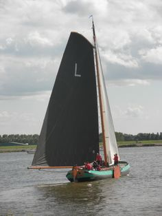 Skutsje a common outdoor activity in the summer is to sail with the family on the frisian lakes