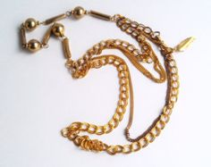 "Vintage Gold Five strand Chunky Costume Necklace 1980s $26.00 | Thank goodness gold is back in style and just in time ... this piece will easily dress up any outfit.  This is a beautifully detailed gold five strand chunky metal costume necklace.  The cool thing with this necklace is you can adjust the length to wear it long or short.   It measures 37"" in length and is in  good vintage condition. Great 80s piece to add to your accessories."