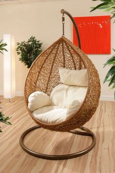 A hanging chair awesome. https://emfurn.com/