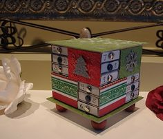 square matchbox advent!  Insert  Peppermints, Dove Chocolates, Charms...