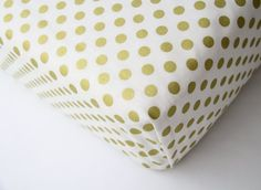 Fitted Crib sheet, changing pad cover, mini crib sheet or pillow made from this stunning gold dot fabric.