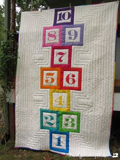 Hopscotch Quilt tutorial. My girls would totally dig this, but I wonder if the white background is asking for trouble.