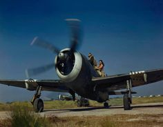 The pilot climbs in to the cockpit of his Republic P 47 Thunderbolt Mk II of No 30 Squadron, Royal Air Force before taking off from Jumchar for a sortie over Burma. The fighter wears the special South East Asia Command striping round the nose and tail surfaces, which served as a friendly identification marking.