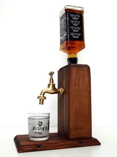 Handmade alcohol dispenser with a brass tap. Fits regular sized bottles mainly up to 1 liter. Plastic drink safe fittings inside. The dispenser system is built into a large solid block of wood. The wood is hand stained and painted with superior danish oil for an alcohol resistant finish. Our system is easy to use, just turn the dispenser upside down insert an open alcohol bottle, turn it upright and youre done. No fittings need to be inserted and no holes need to be drilled, unlike many…