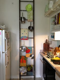 Old heavy ladder to hang your pots and pans!