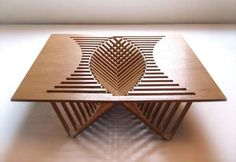 Sunken Furniture Surfaces -  Rising Table by Robert van Embricqs is Organically Intricate #table #interiordesign #design