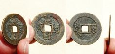 A 'Kang Xi Tong Bao' (康熙通寶) 1 cash coin cast during the reign of Emperor Kangxi (1661-1722 AD). The reverse side of this coin features the mint name in Manchu (left side) and in Chinese (right side) which shows the Chinese character 'Yuan'(原), indicating this coin was cast at the 'Taiyuan' Mint located in Shanxi Province.  Both sides of this coin still bear the original filing marks indicating this coin was not in general circulation very long.   28mm in size; 5 grams in weight.  S-1429.
