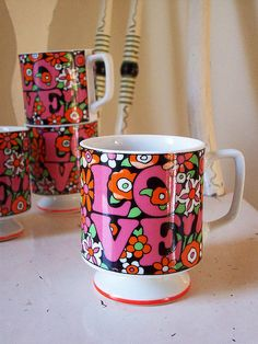 LOVE mugs. I don't know if these are old, reproductions or just designed to look vintage, but I love 'em!