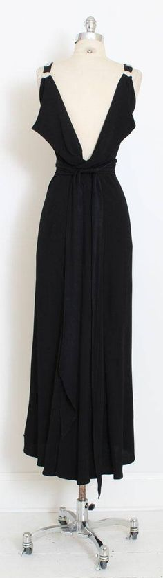 ➳ vintage 1930s dress * absolutely stunning gown! * black rayon crepe * open back with winged panels * detachable rhinestone belt ties in back * side snap closure  condition | excellent fits like xs/s  length 56 bodice 16 bust 36-40 waist 28-30 (unbelted) hips 34-38  ➳ shop http://www.etsy.com/shop/millstreetvintage?ref=si_shop  ➳ shop policies http://www.etsy.com/shop/millstreetvintage/policy  twitter | MillStVintage facebook | millstree...