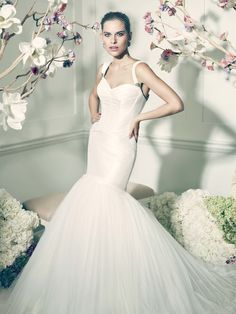 ae871a22ff0 Zac Posen recently launched his bridal collection with David s Bridal and I  must say its pure glamour. The Truly Zac Posen line features seven romantic  ...