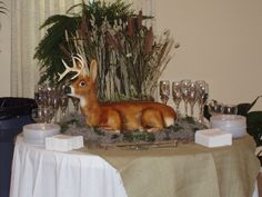 Cake was made using Janette Pohlman's deer kit and instructions. www.pohlmanscakes.com  , click on animal kits.  The body is cake, the head is a form. All is iced in buttercream and airbrushed.  Many times guests do not realize it is a cake until it is cut into!