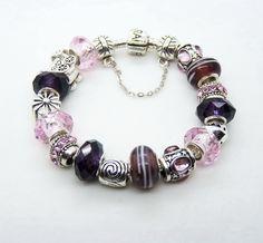 I love my Pandora charm bracelet.....I need new charms.... ;)