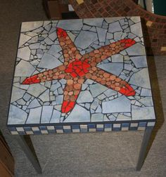 Mosaic Starfish Table from Daniel Boivin: A small table decorated with one unique starfish.
