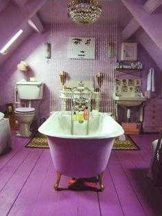 bathroom design with bathtub and floor in purple color