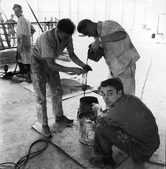 Yves Klein working on the installation at Gelsenkirchen Opera house, Germany, 1959. © 2010 Artists Rights Society (ARS), New York/ADAGP, Paris. Photo by and © Charles Wilp. Courtesy Yves Klein Archives
