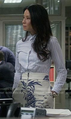 Joan's pineapple print skirt and striped shirt on Elementary.  Outfit Details: https://wornontv.net/56989/ #Elementary