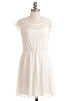 Just bought this for my engagement photos! The tulle overlay has little white hearts on it! It's sooo cute! Pairing it with my cowgirl boots :)