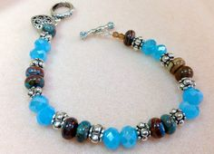 Bracelet Dyed Rhodonite Aqua Rondele Brown and by JewelryCharmers, $23.00
