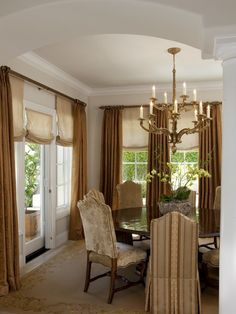 Linen roman shades with drapery panels--would work for my French doors.