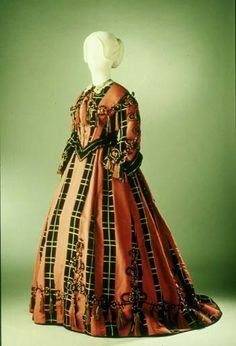 A silk gown, dating to the mid-late 1860s.