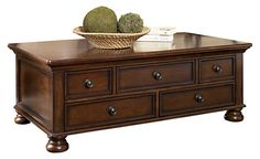 coffee table  http://www.ashleyfurniturehomestore.com/catalog/product.aspx?group=LivingRoomFurniture&category=LivingRoomAccentTables&id=T697-20&spi=0&ref=search-t