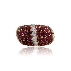 A stunning Bombe design Van Cleef and Arpels Vintage Cocktail Ring. Three rows of prong set circular diamonds and eight rows of prong set rubies adorn the top of this rare VCA cocktail ring. The beautifulmounting is 18K yellow gold. Signed Van Cleef and Arpels, circa 1950. Ruby Rings, Prong Set, Cocktail Rings, Christmas Bulbs, Diamonds, Van, Yellow, Holiday Decor, Gold