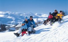 Families descend with a sled